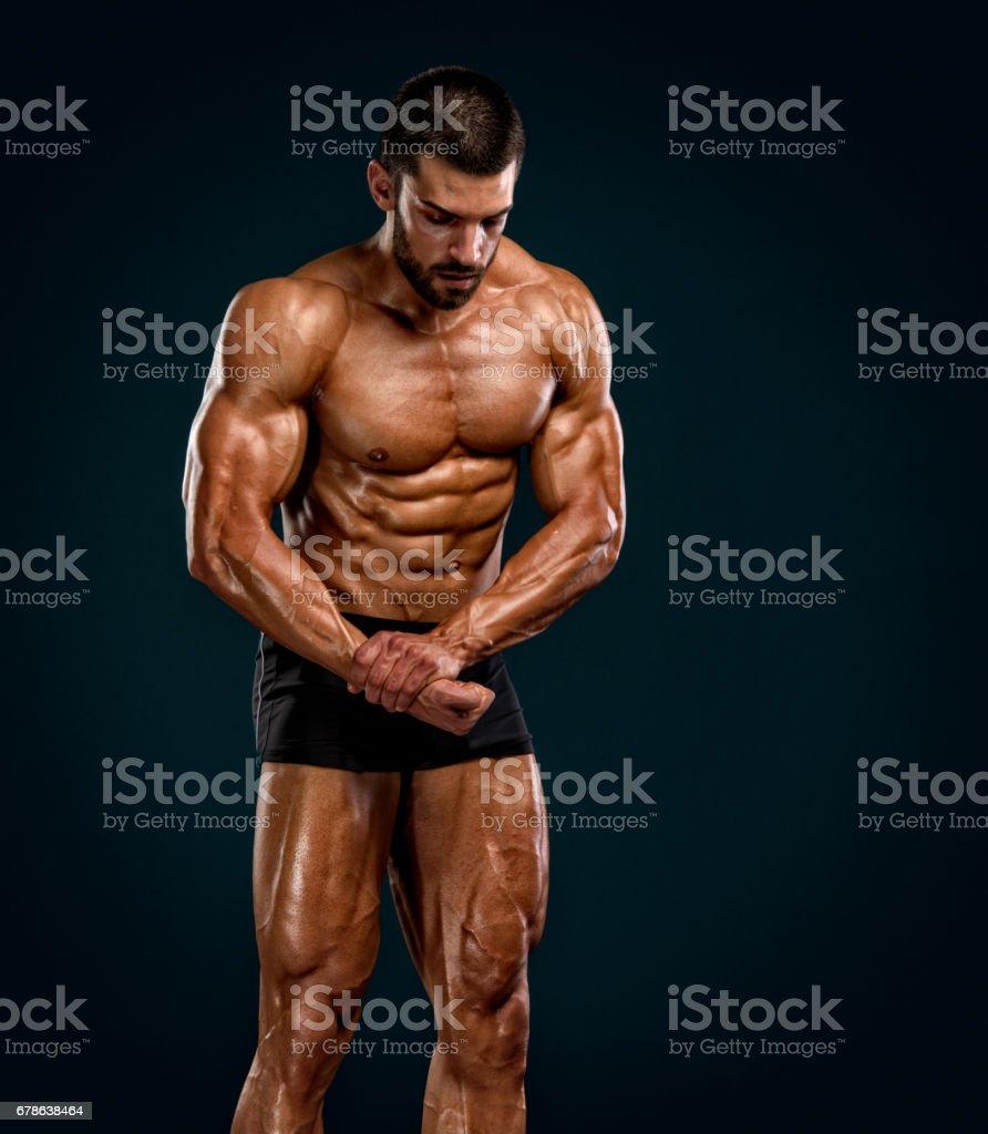 GEORGETTE: Muscle men flexing