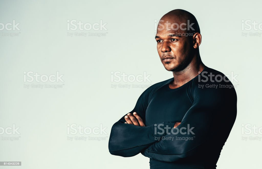 Muscular men in long sleeve gym t-shirt stock photo
