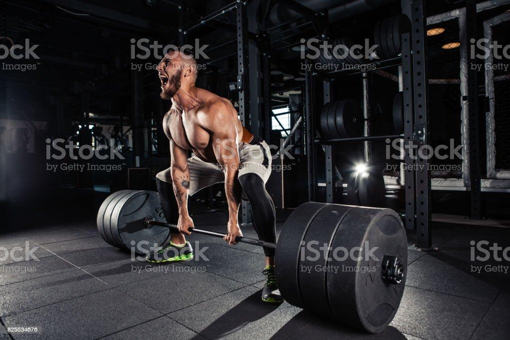 Muscular men lifting deadlift - foto stock