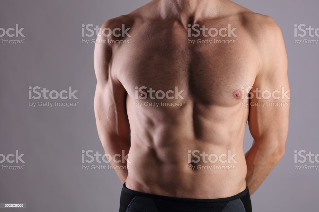 Muscular Men, perfect body, abs, six pack. Strong athletic guy showing his torso. Bodybuilding, sport, fitness ,workout, active lifestyle concept. stock photo