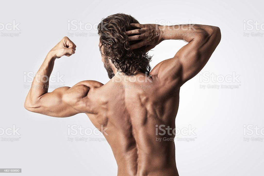 Muscular Men Showing His Back Muscles Stock Photo More Pictures Of