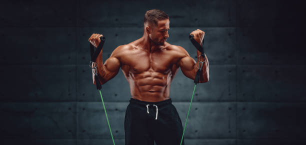 Muscular Men Training With Resistance Band stock photo