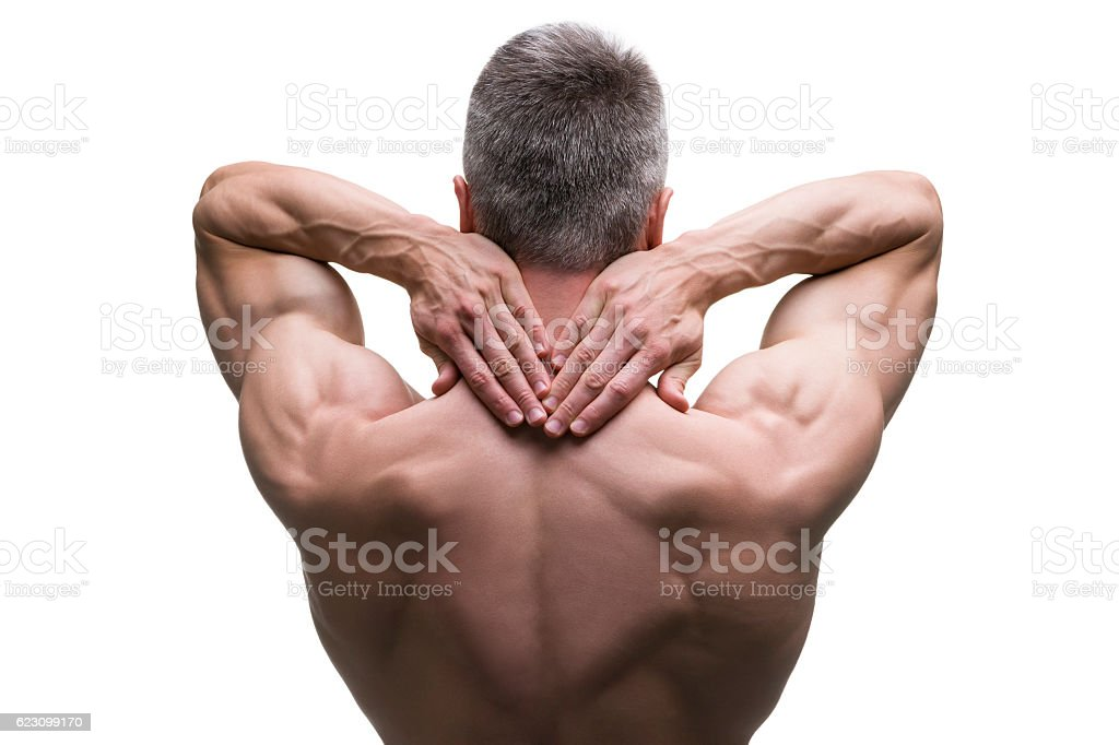 Muscular middle-aged man posing on white background, isolated stock photo