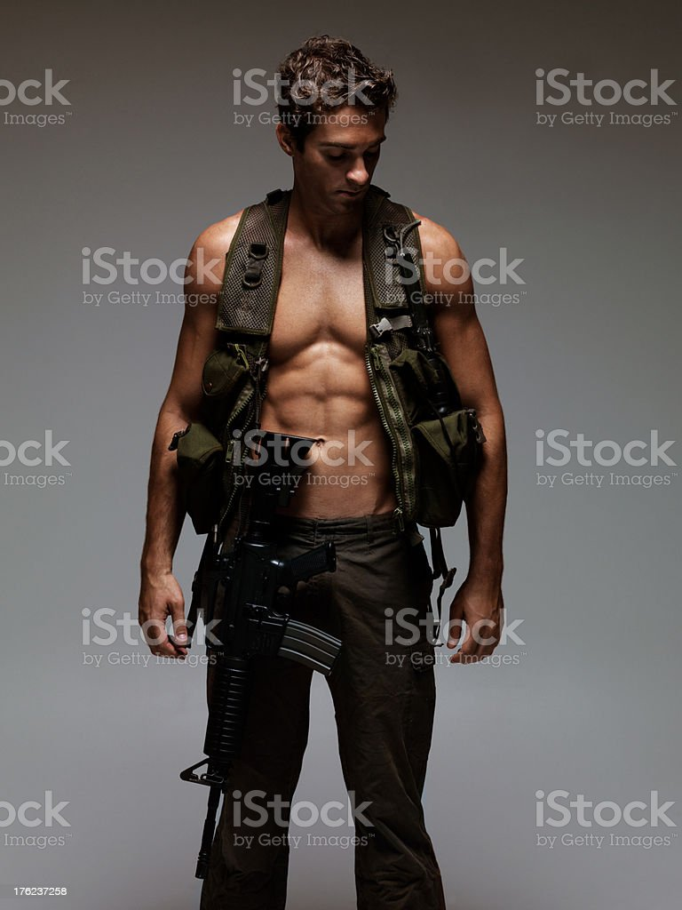 Muscular military man stock photo