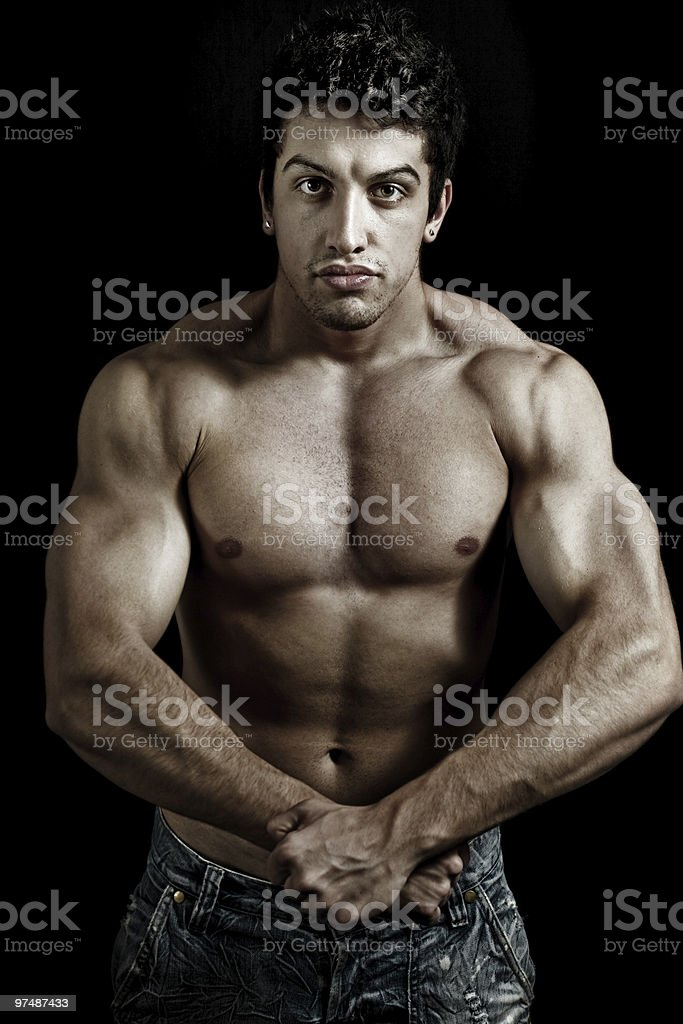 Muscular powerful man showing his muscles royalty-free stock photo