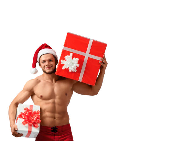 muscular santa claus holding presents - naked santa claus stock pictures, royalty-free photos & images