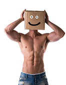 istock Muscular shirtless bodybuilder with smiling box on head 499172331