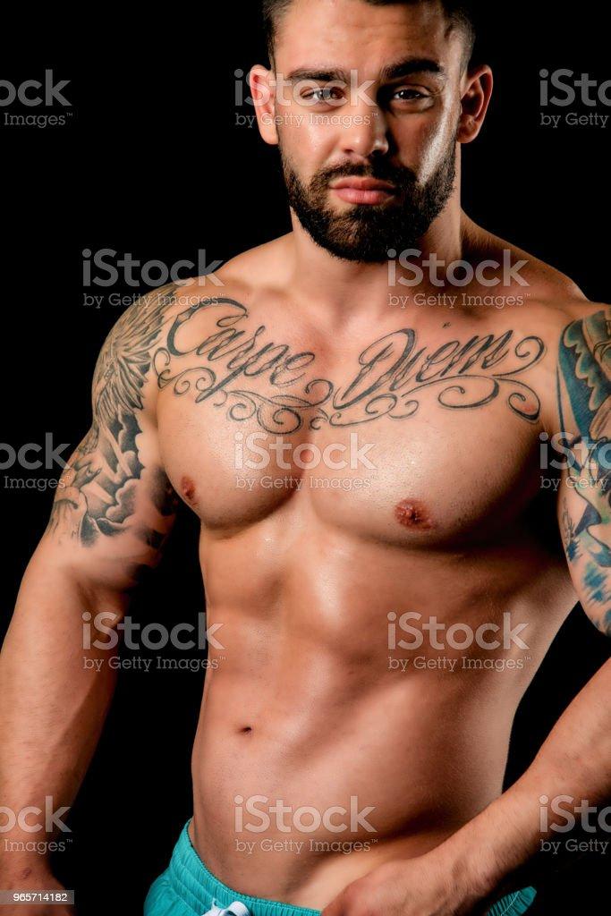 Muscular Shirtless Man In Studio - Royalty-free 20-29 Years Stock Photo