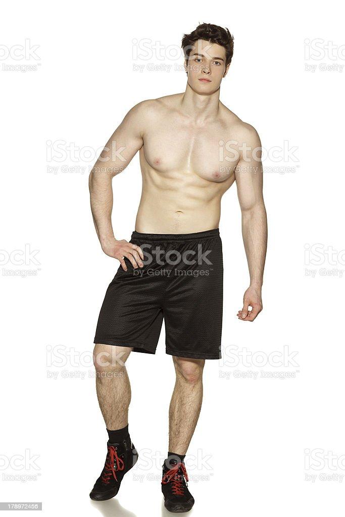 Muscular sportsman shirtless royalty-free stock photo