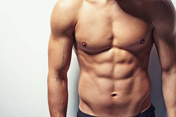 Muscular torso of young man Very muscular and sexy torso of young man with copy space shirtless male models stock pictures, royalty-free photos & images