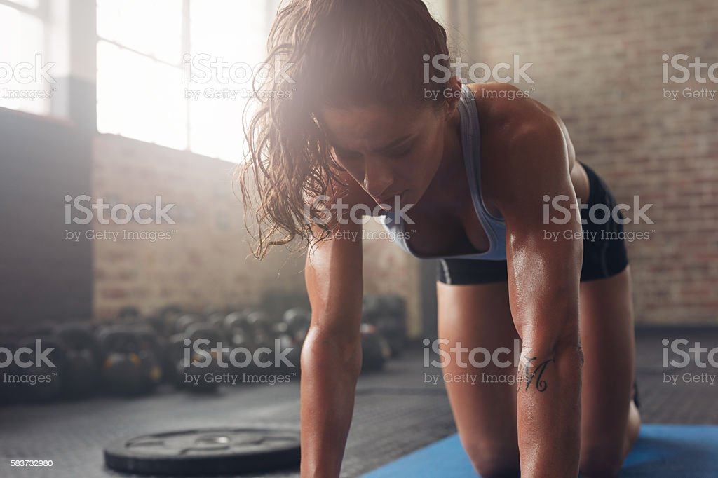 Muscular woman exercising at fitness club stock photo