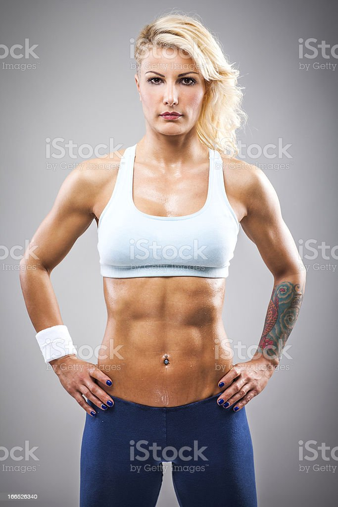 Muscular woman posing royalty-free stock photo