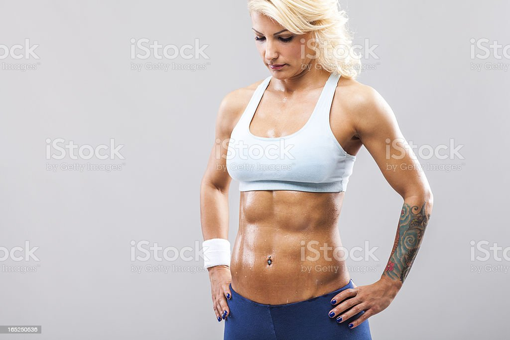 Muscular woman - relaxation after work out royalty-free stock photo