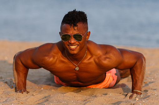 Muscular Young Athletic Sexy Man On The Beach With A Naked