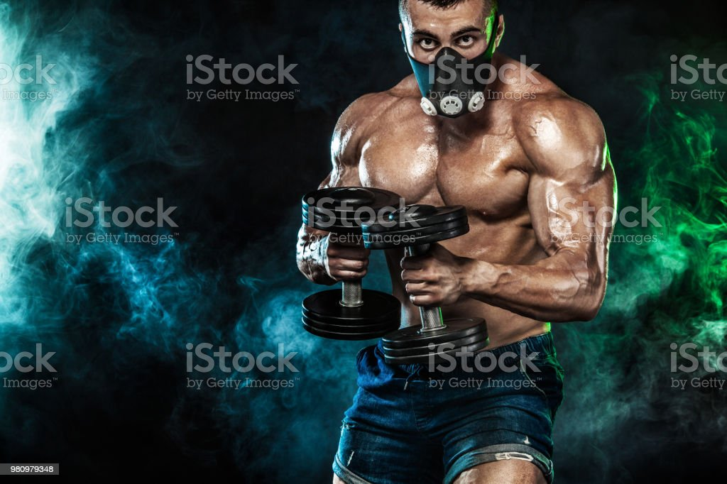 Muscular Young Fitness Sports Man Bodybuilder In Training Mask