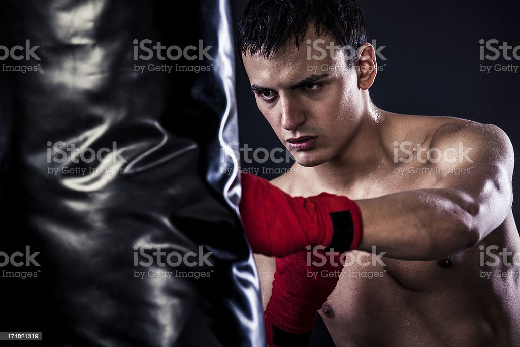 Muscular young man boxing in a gym royalty-free stock photo