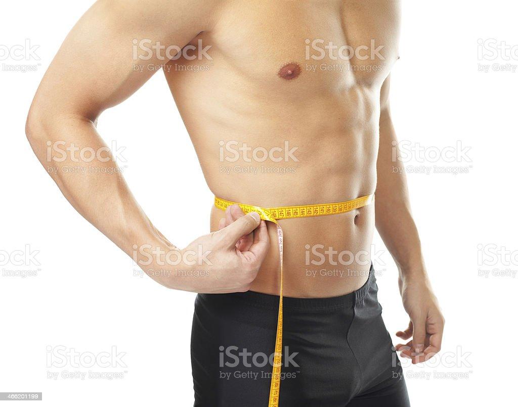 Muscular joven medir la cintura - Foto de stock de Abdomen libre de derechos