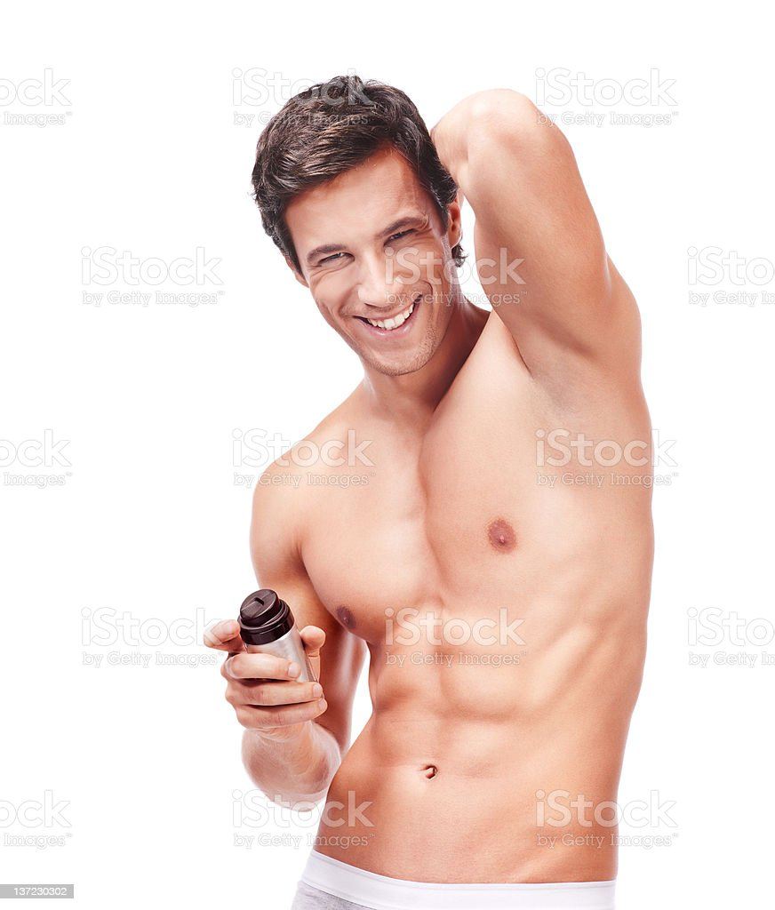 muscular young man with deodorant royalty-free stock photo
