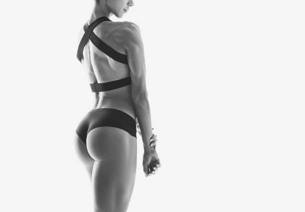 muskulös ung kvinna idrottsman - bum bildbanksfoton och bilder