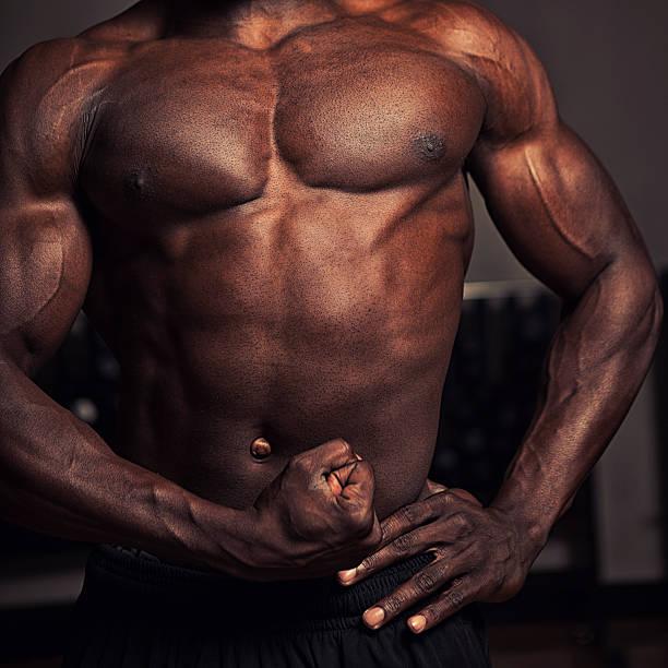 muscule flexing stock photo
