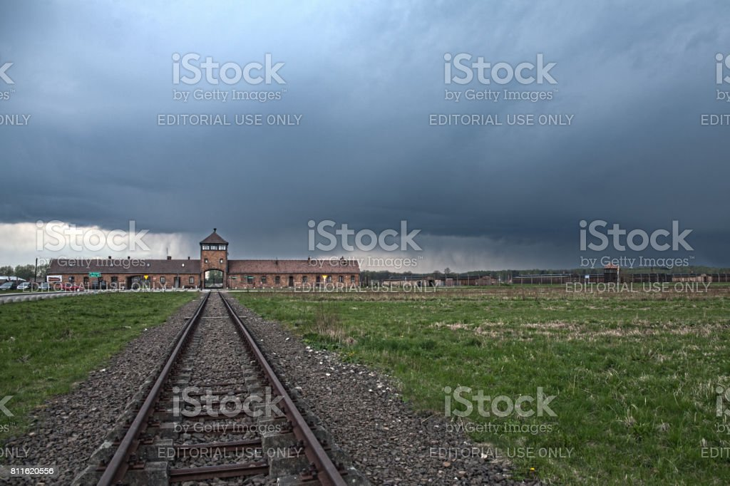 Museum Auschwitz - Birkenau. Holocaust Memorial Museum. Main entrance to the concentration camp. Barbed wire around a concentration camp. – zdjęcie
