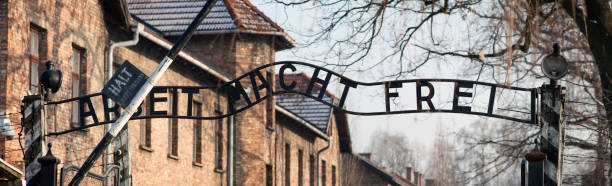 Museum of Holocaust Auschwitz Birkenau. The inscription above the gate to concentration camp  Auschwitz. work makes you free. Sentence, work makes you free. – zdjęcie