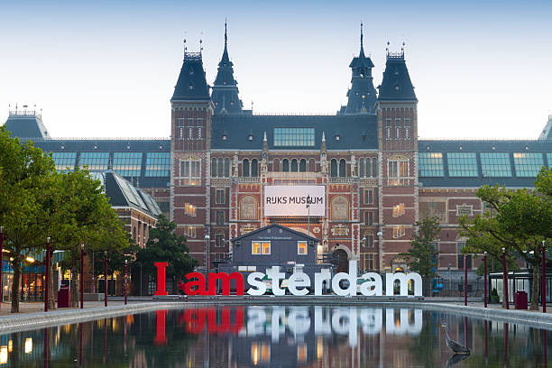 Museum reflection Amsterdam ,The Netherlands - September 4, 2012: 'I amsterdam' sign in front of the National state museum at the museumsquare on September 4 in Amsterdam, the Netherlands. The national state museum first opened in 1800 and is a popular tourist destination museumplein stock pictures, royalty-free photos & images