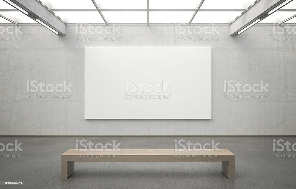 Museum with Image Royalty-free image of a modern museum with an empty canvas for you to fill. The room features clear architecture and smooth lighting. The used materials are highly detailed and accurately constructed. Zoom in to see the pores in the concrete or the individual stones embedded in the asphalt floor. Architecture Stock Photo