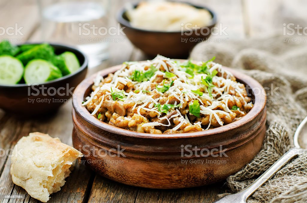 mushroom and barley stew with cheese stock photo