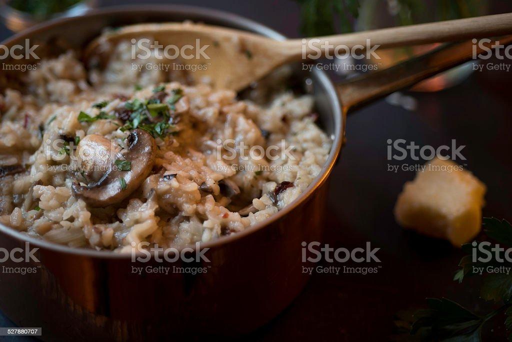 Mushroom and Sun-dried Tomato Risotto in a Copper Saucepan royalty-free stock photo