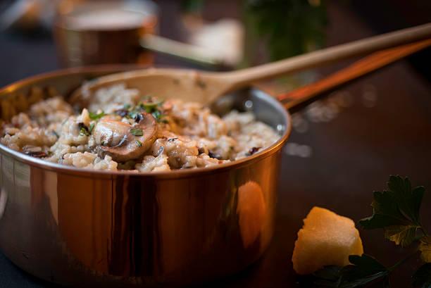 Mushroom and Sun-dried Tomato Risotto in a Copper Saucepan stock photo