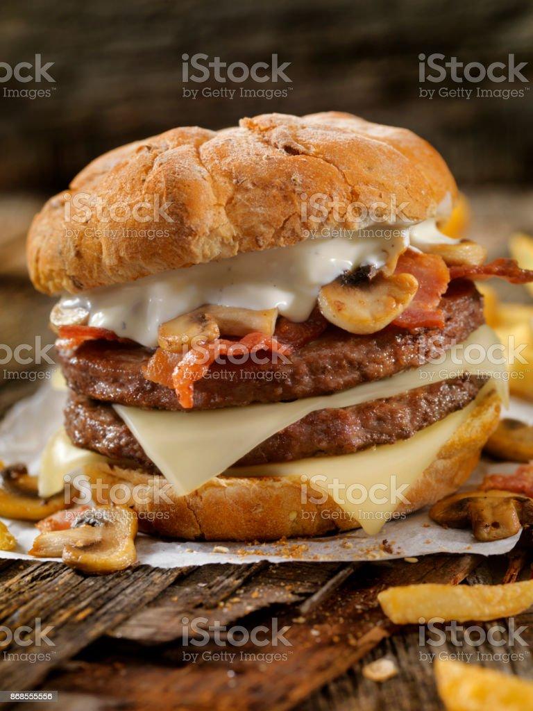 Mushroom, Bacon, Swiss Burger with Blue Cheese Dressing stock photo
