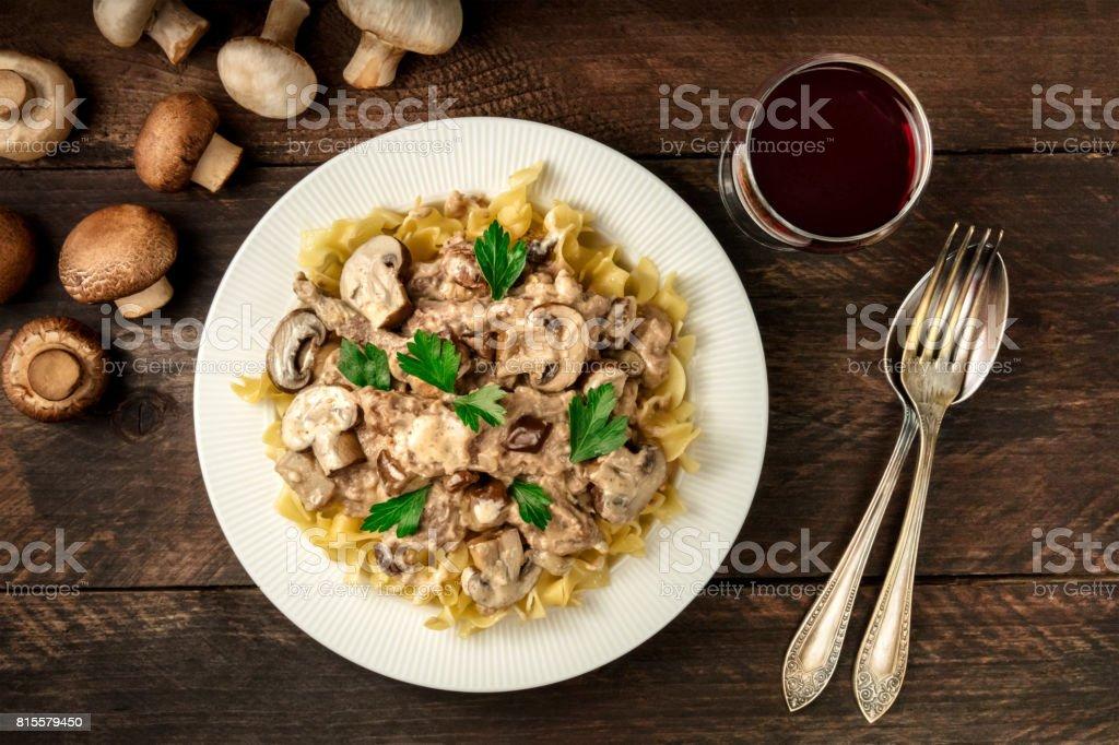 Mushroom beef stroganoff with egg pasta and red wine stock photo