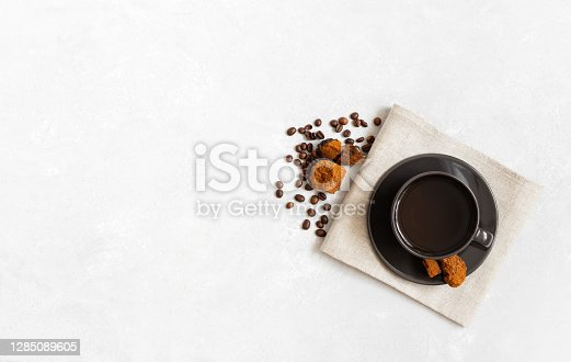 Mushroom chaga coffee superfood on white background. Trendy healthy drink. Space for text. Top view, flat lay.
