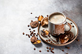 Mushroom coffee, a ceramic cup, mushrooms and coffee beans on stone concrete background. New Superfood Trend. Copy space, selective focus.