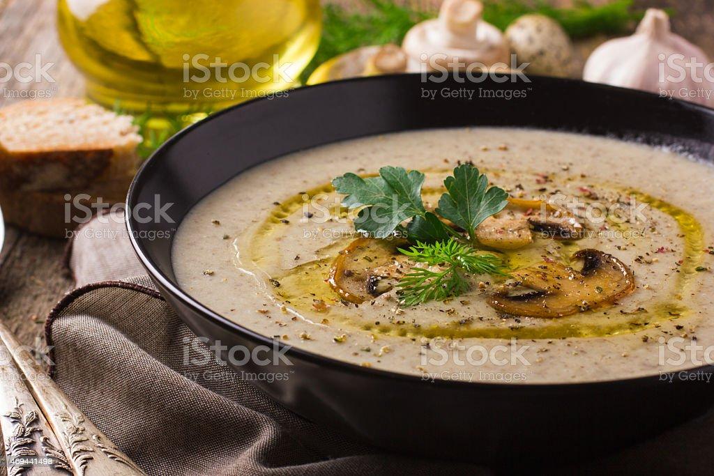 Mushroom cream soup on rustic background stock photo