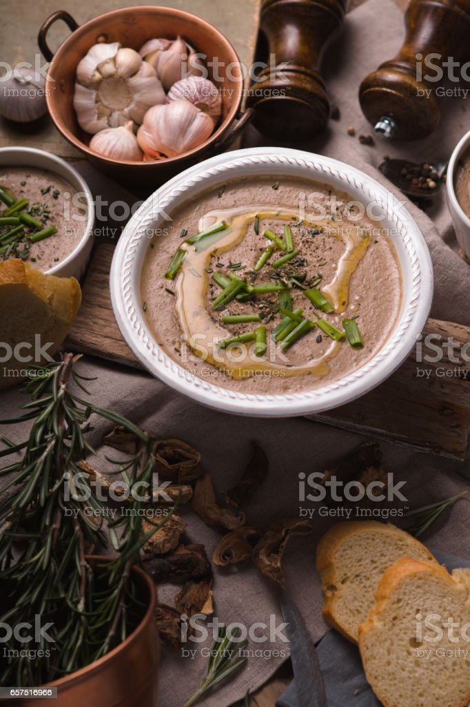 Mushroom cream soup on the rustic background vertical stock photo