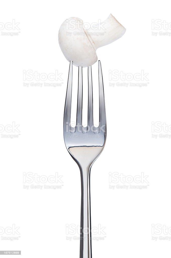 mushroom on a fork royalty-free stock photo