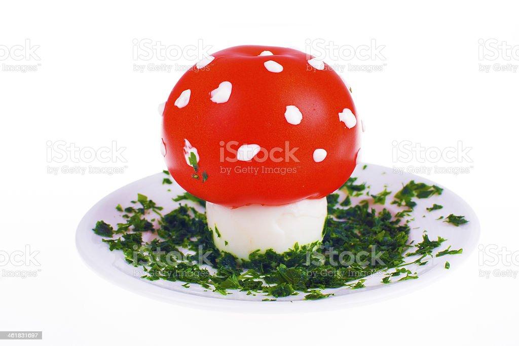 Mushroom shaped egg and tomato stock photo