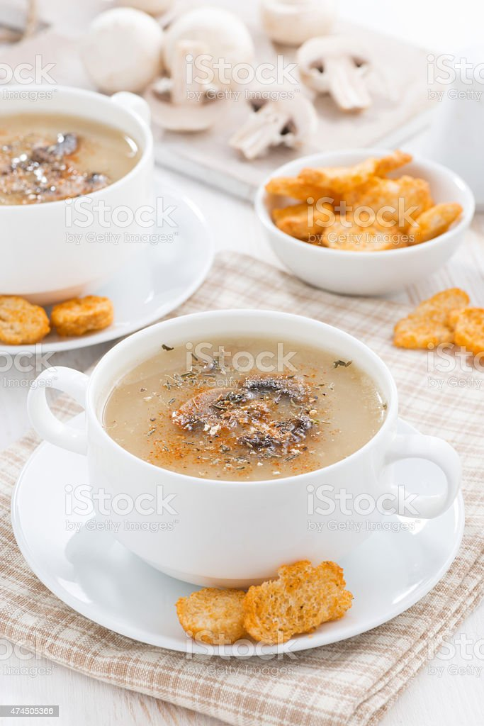 mushroom soup puree with croutons, vertical stock photo