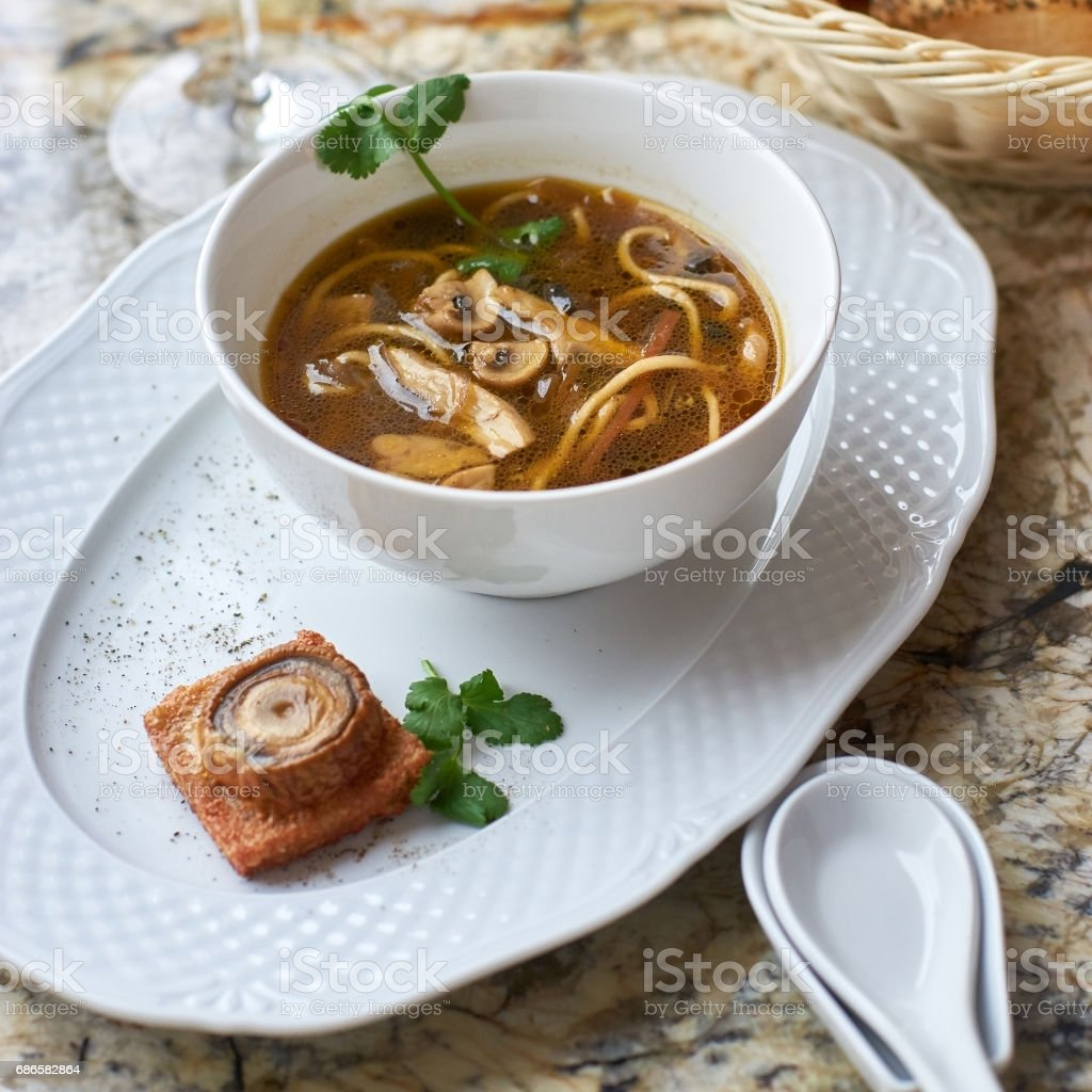 Mushroom soup with egg noodles royalty-free stock photo