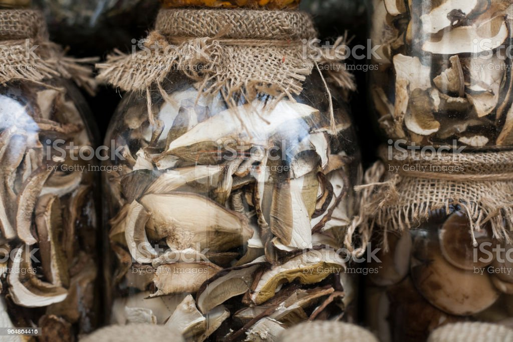 Mushrooms are dried and canned in cans. Traditional rural market food. royalty-free stock photo