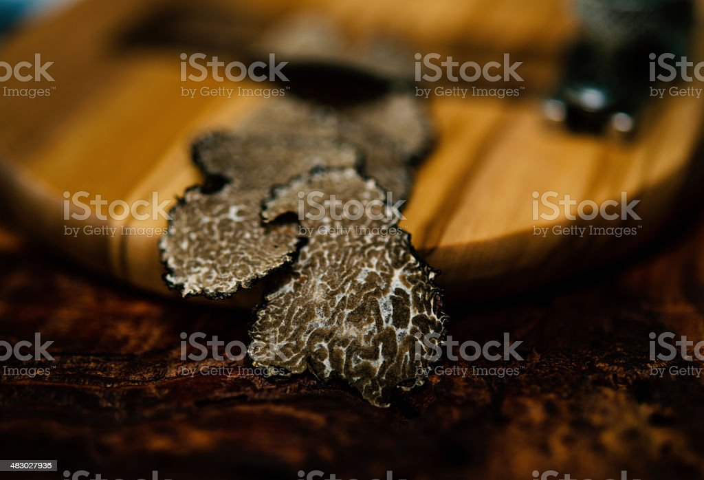 mushrooms black truffle on on a wooden board stock photo