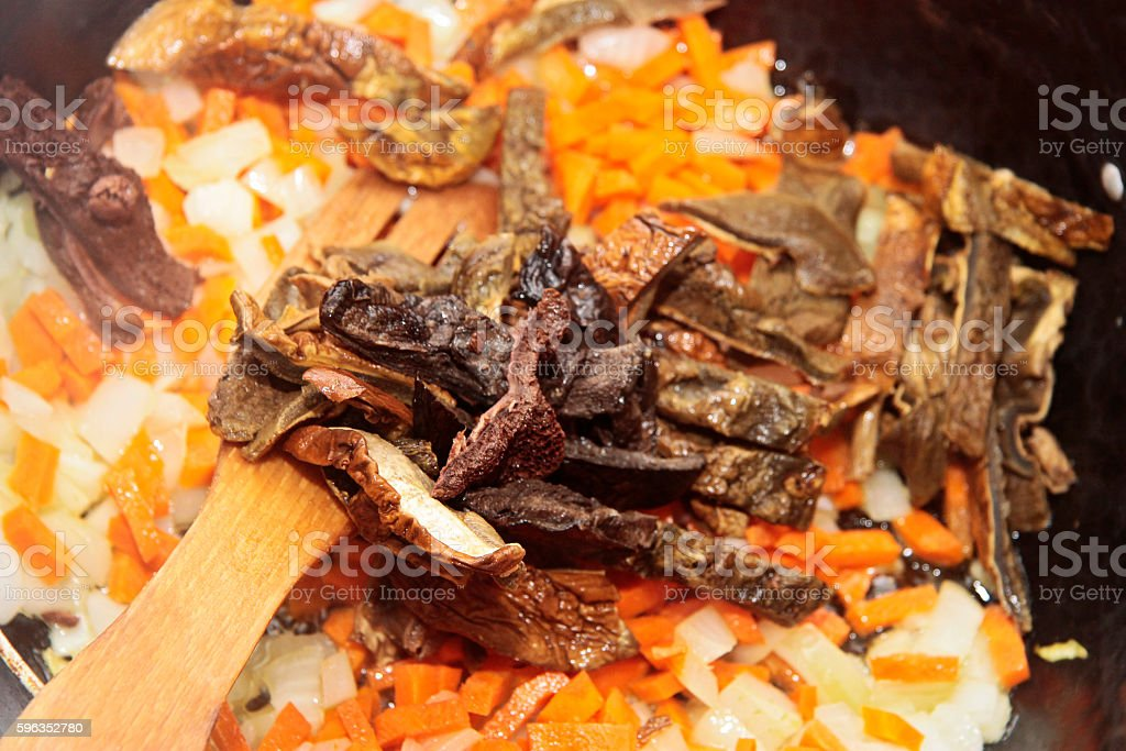 Mushrooms fried on the pan with carrot and onion royalty-free stock photo