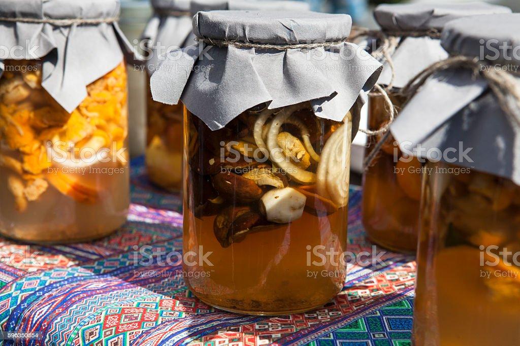 Mushrooms marinated jars royalty-free stock photo