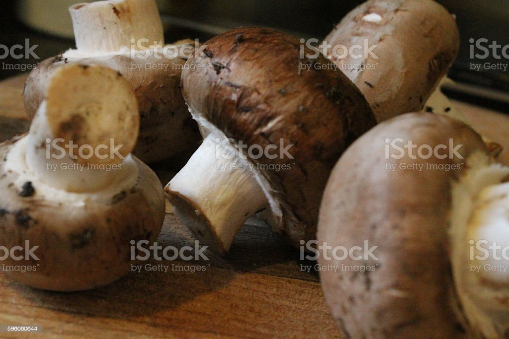 Mushrooms on a Cutting Board royalty-free stock photo