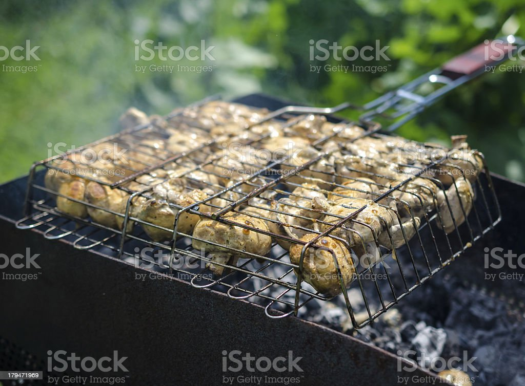 Mushrooms on the grill royalty-free stock photo