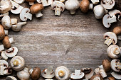 Mushrooms on wooden background - copy space