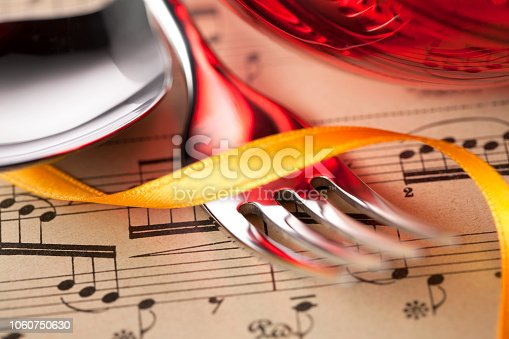 Music and cook. Musical score reflected into cutlery.