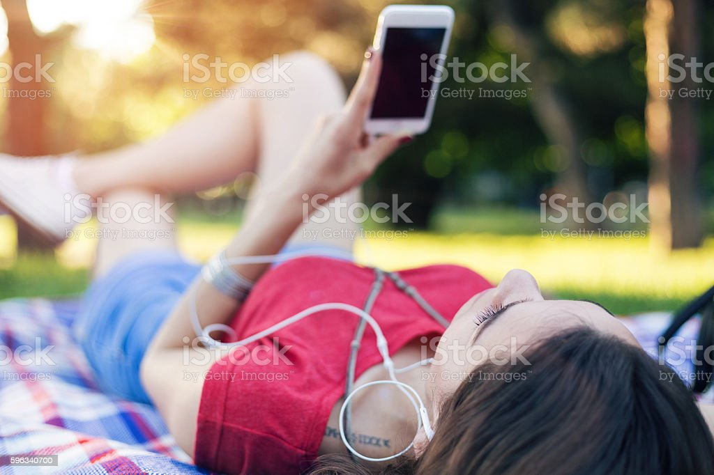 Music and news feed in the park royalty-free stock photo